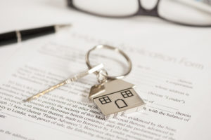 deed papers with keys to house